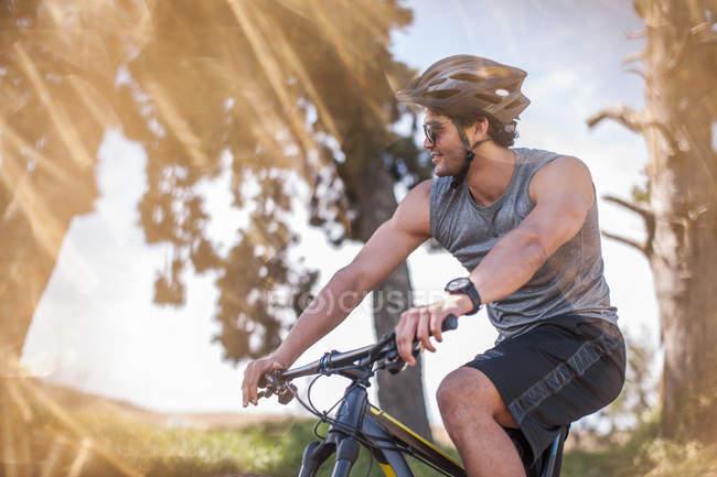 Young man mountain biking in nature — Stock Photo