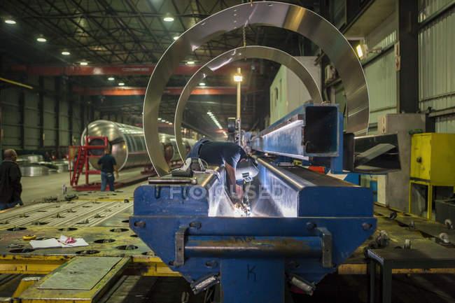 Man welding steel in factory — Stock Photo