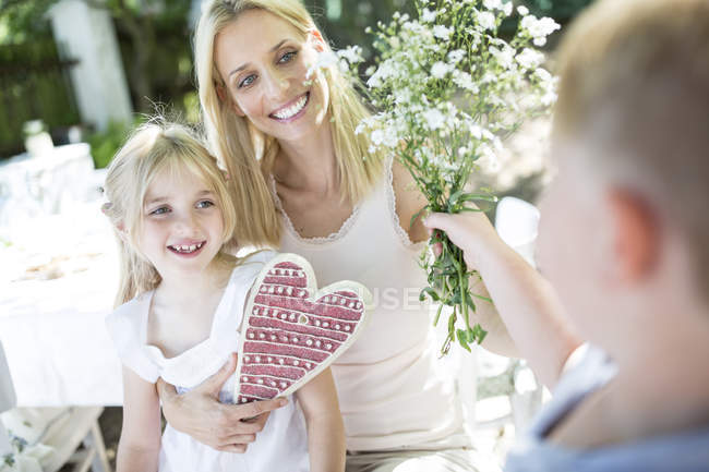 Happy mother receiving Mothers Day gifts from kids — Stock Photo