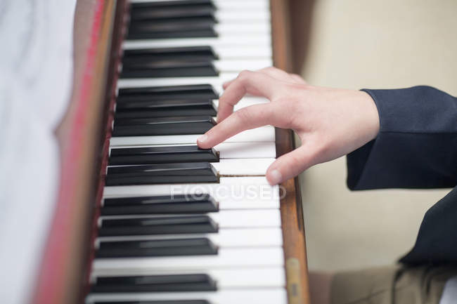 Close-up of hand playing piano — Stock Photo