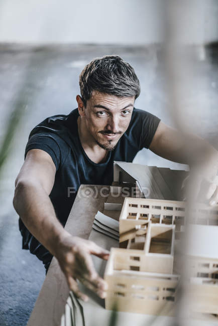 Portrait of confident architect working on architectural model — Stock Photo