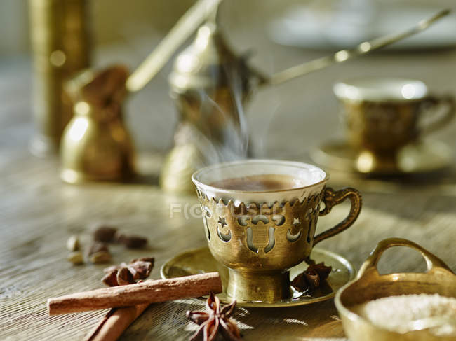 Cup of steaming mocha on table — Stock Photo