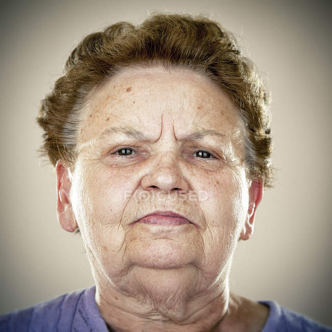 Portrait of calm senior woman looking at camera — Stock Photo