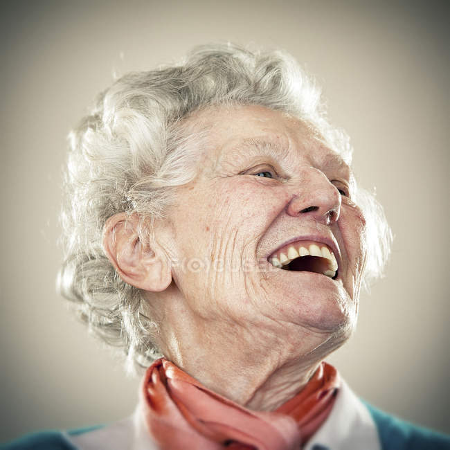 Portrait of laughing senior woman looking aside — Stock Photo