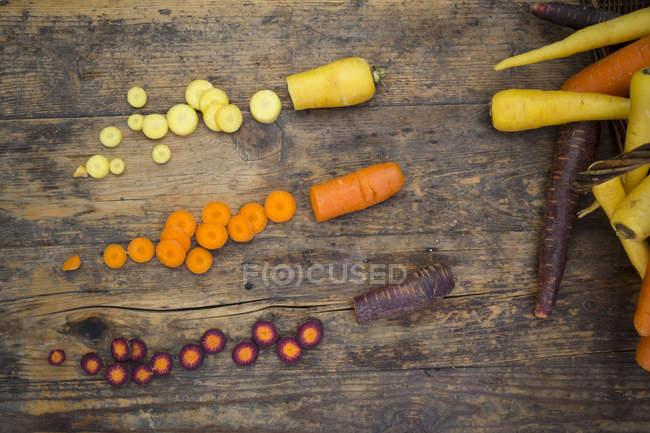 Partly sliced fresh carrots — Stock Photo