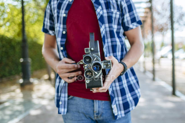 Close-up of  man holding an old-fashioned camera — Stock Photo