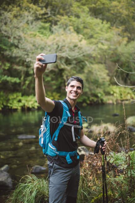 Hiker man taking selfie in nature — Stock Photo