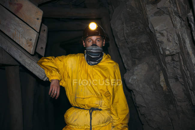 Bolivia, Potosi, tourist wearing protective clothing standing in adit of the Cerro Rico silver mine — Stock Photo