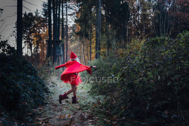 Little imp spinning and dancing in forest — Stock Photo
