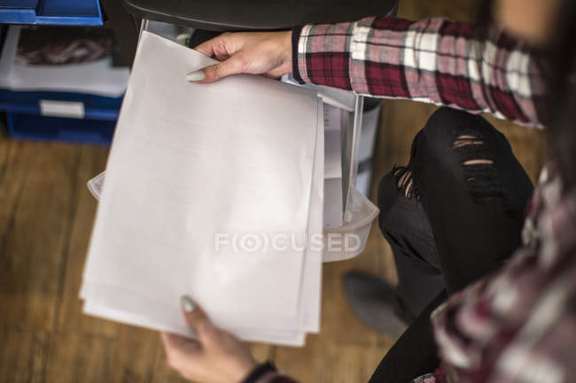 Woman's hands holding sheets of paper — Stock Photo
