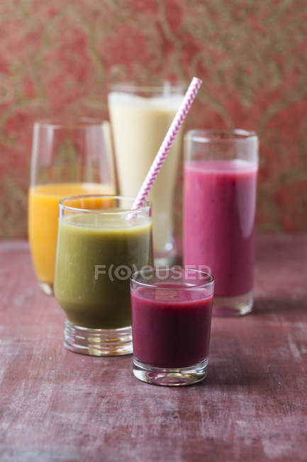 Five glasses of different smoothies — Stock Photo