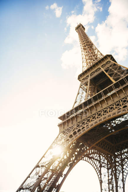 Champ-de-Mars, Paris, France. Blurred Eiffel Tower with sunbeams bottom view — Stock Photo