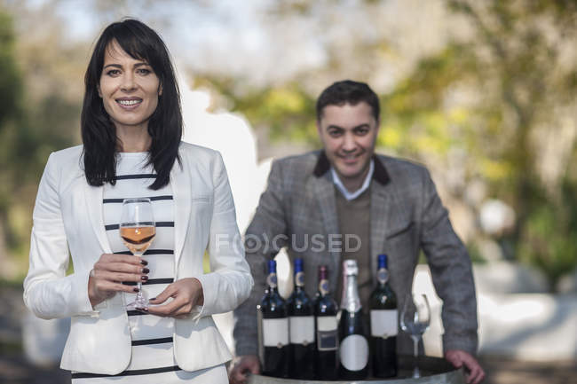Wine sales people presenting wine at estate function — Stock Photo