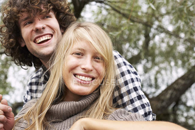 Happy young couple hugging outdoors — Stock Photo