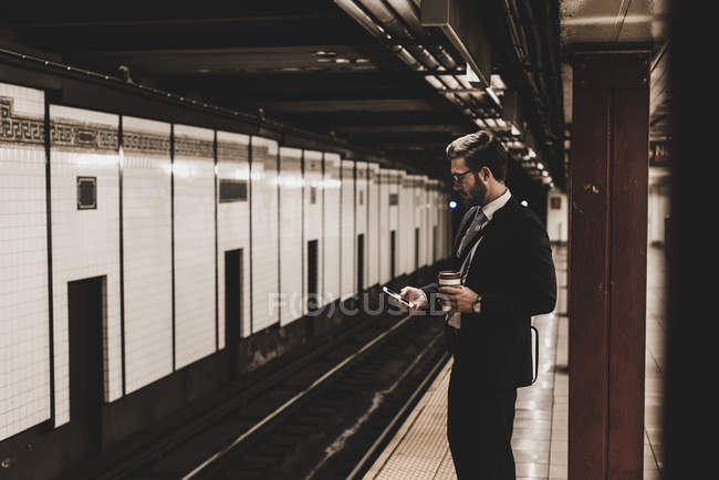 Businessman waiting at metro station — Stock Photo