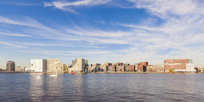 View of buildings against water during daytime, Holland — Stock Photo