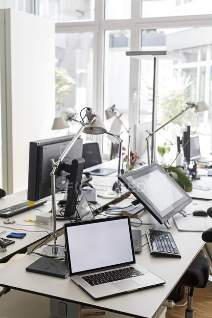 Computers on desk in office — Stock Photo