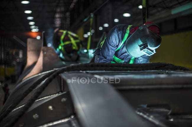 Man welding steel in factory — Stock Photo