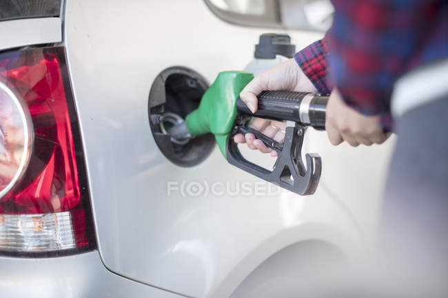 Close up of Woman fueling car — Stock Photo