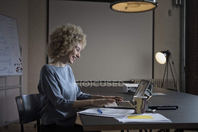 Woman having video conference in office with laptop — Stock Photo