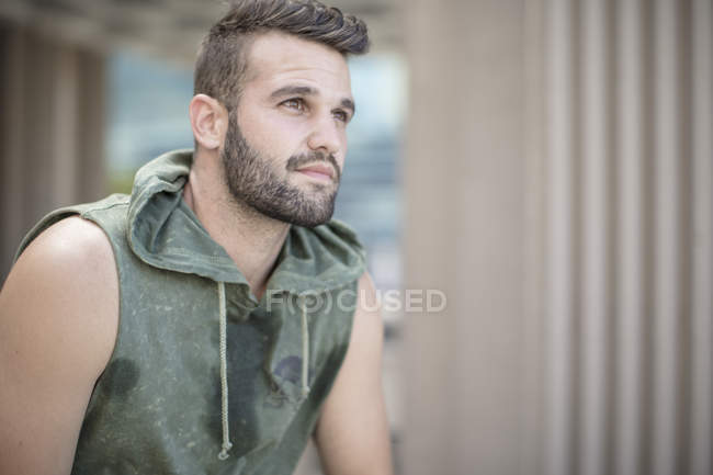 Athlete taking a break in the city — Stock Photo