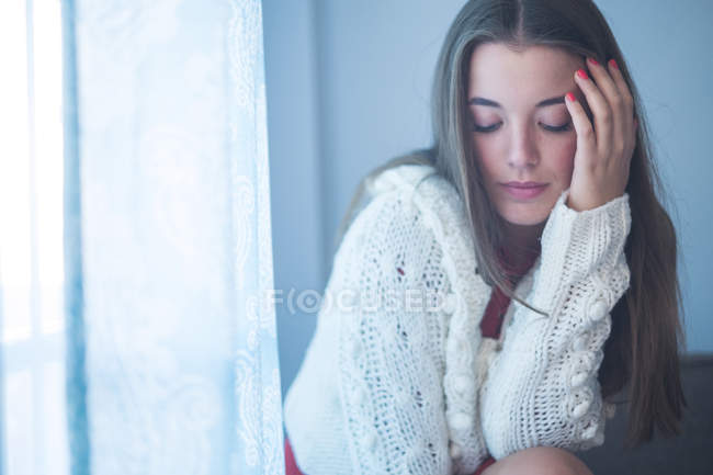 Portrait of young woman looking down — Stock Photo
