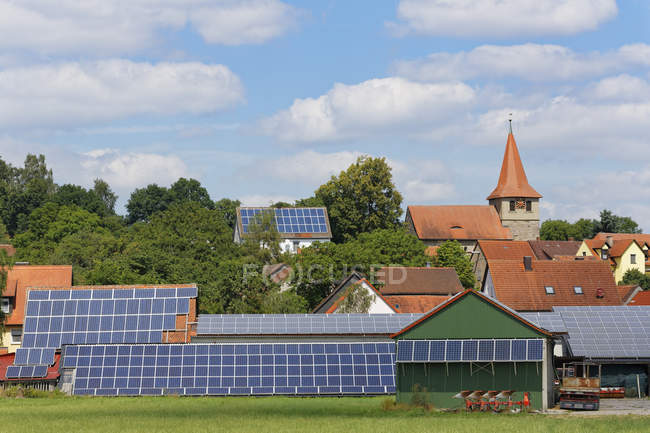 Germany, Stettberg, solar panels and rural houses — Stock Photo