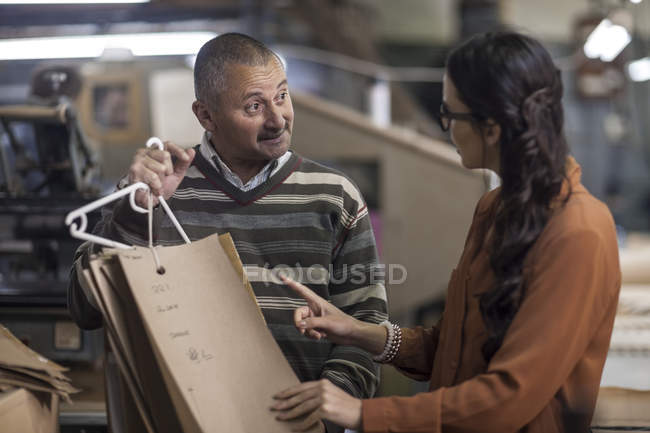 Tailor and fashion designer discussing cutting patterns — Stock Photo