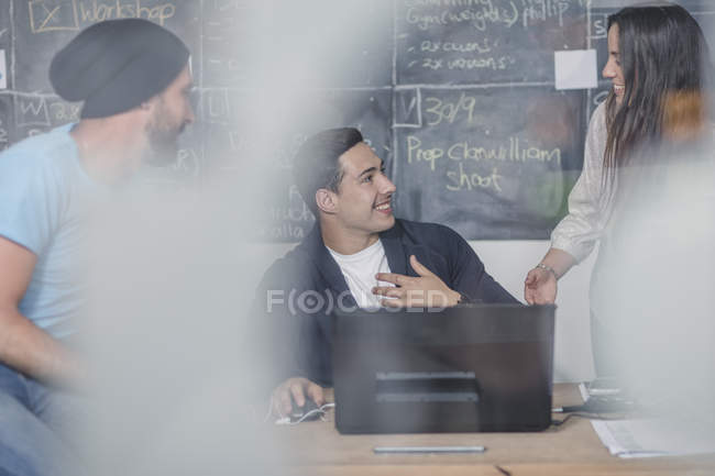 Business people discussing during informal meeting — Stock Photo