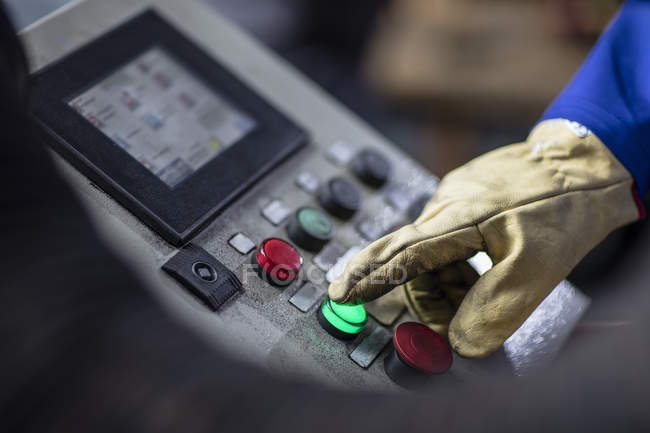 Hand operating control panel in factory — Stock Photo