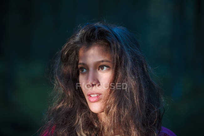 Portrait of young woman in the woods — Stock Photo