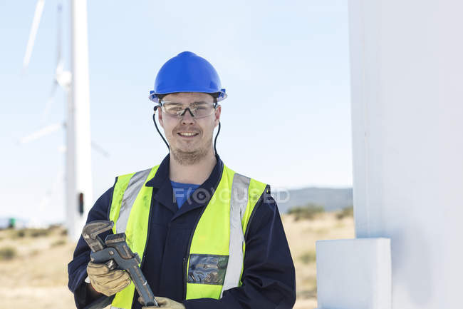 Engineer at wind farm holding wrench — Stock Photo
