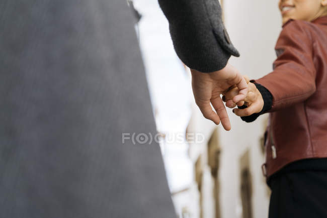 Close-up of Two young women holding hands — Stock Photo