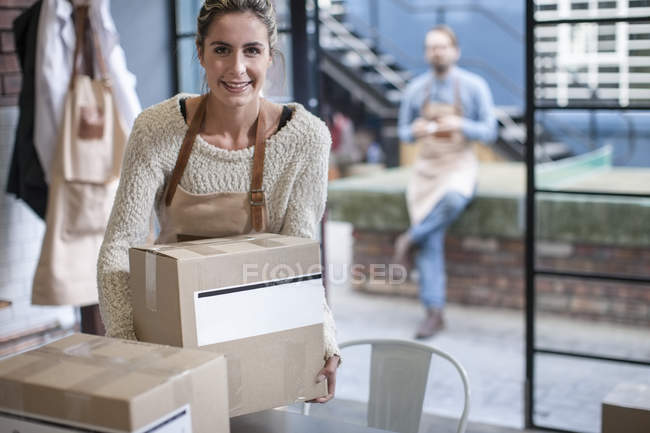 Woman with cardboard box — Stock Photo