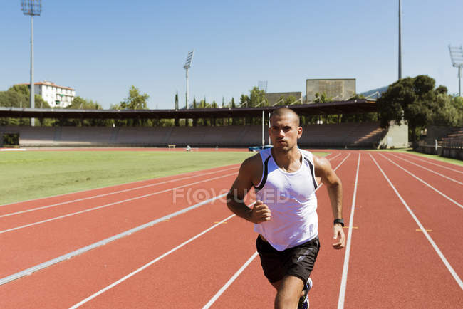 Young sportsman running — Stock Photo