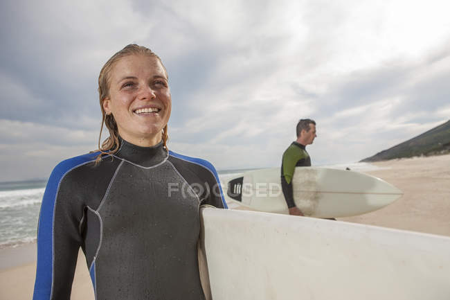 Smiling young woman with surfboard — Stock Photo
