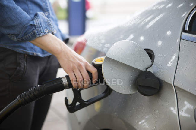 Close up of Woman fuelling car — Stock Photo