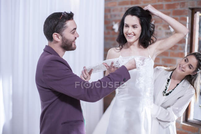Woman trying on wedding dress — Stock Photo