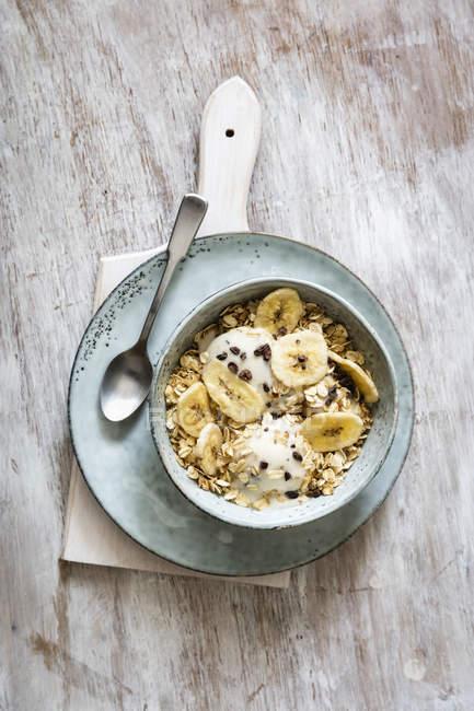 Banana icecream with oat flakes, topping, nicecream — Stock Photo