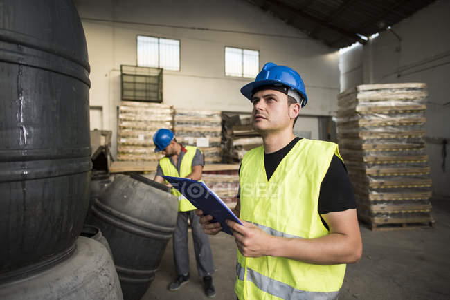 Workers making barrels inventory — Stock Photo