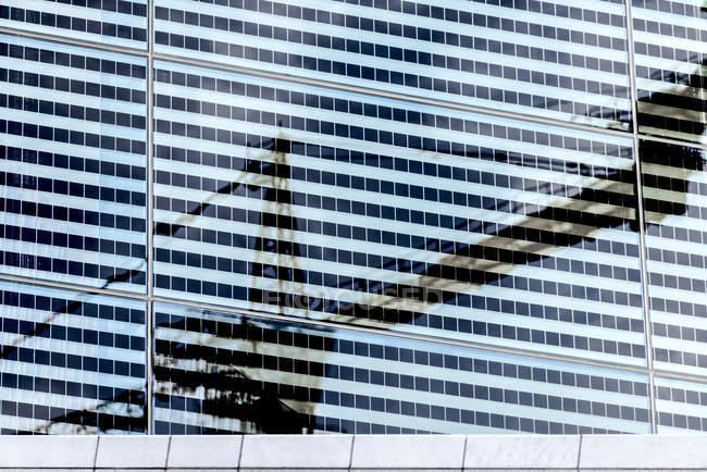 Reflection of construction crane — Stock Photo