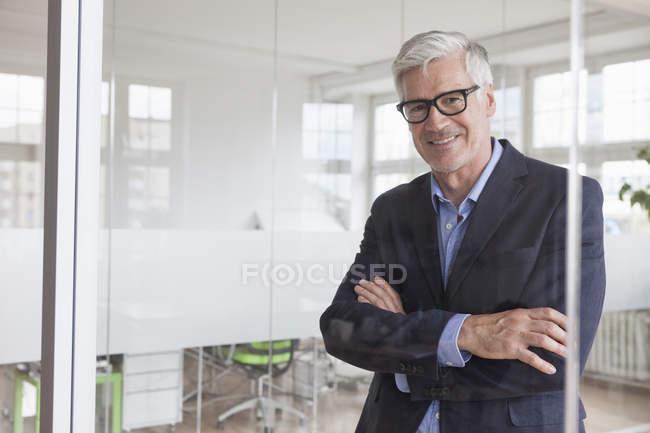 Smiling mature businessman — Stock Photo