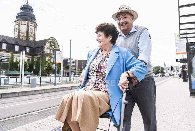 Senior couple with wheeled walker — Stock Photo