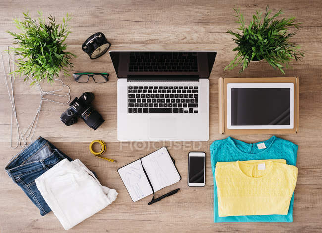 Top view of Different items on desk with gadgets — Stock Photo