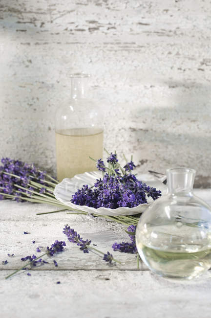 Glass Bottles Of Lavender Oil And Lavender Water Color Image