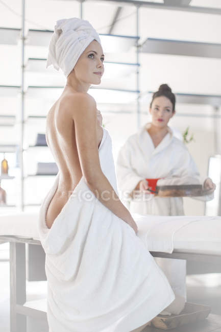 302d52080e Young woman wrapped in towel — two people, young adult - Stock Photo ...
