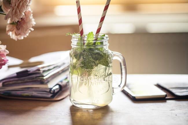 Homemade herb lemonade, notebook, smartphone, homeoffice — Stock Photo