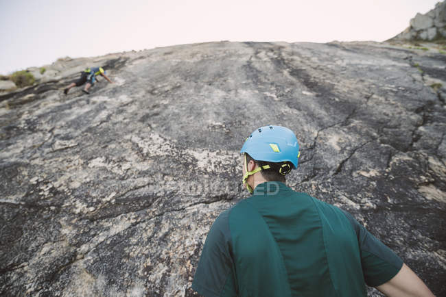 Close-up of Climber looking up on rock wall — Stock Photo