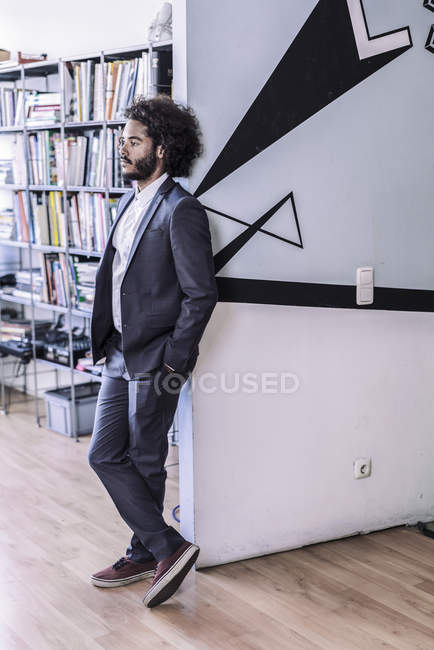Creative businessman standing in office — Stock Photo