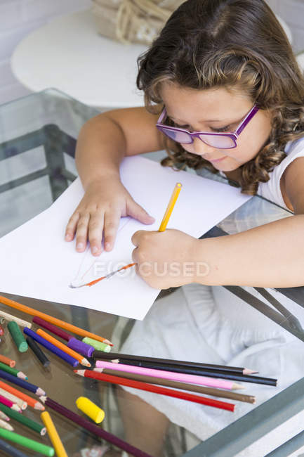 Girl painting with coloured pencils at home — Stock Photo